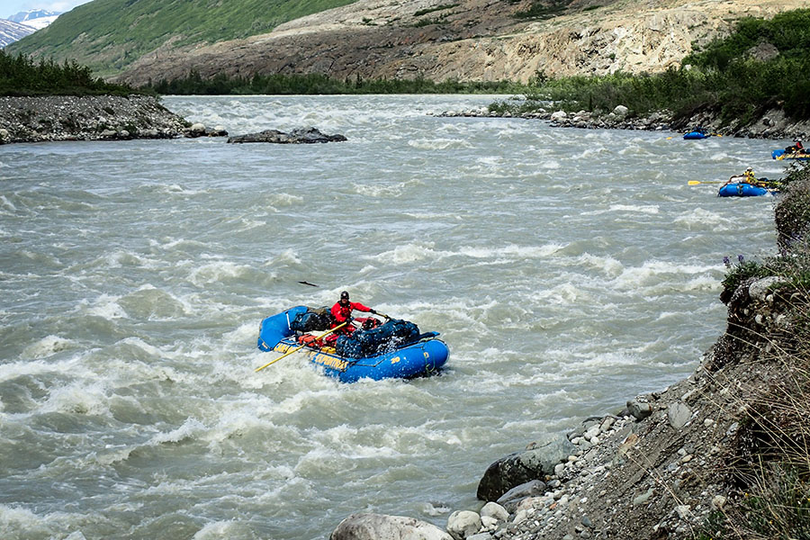 Rafting through rapids on our Alsek River Rafting Expedition.