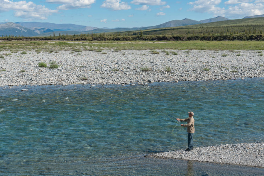Man fishing, Firth River Rafting, Ivvavik National Park, Yukon Territory.