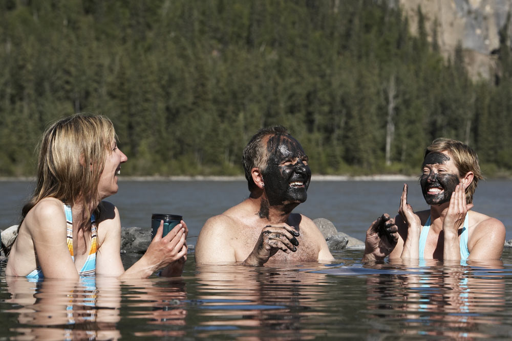 People soaking in Kraus Hot Springs on the Nahanni River in Nahanni National Park in Canada's Northwest Territories.