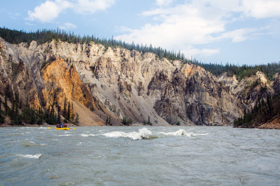 Rafting through rapids on the Nahanni River in Nahanni National Park in Canada's Northwest Territories.