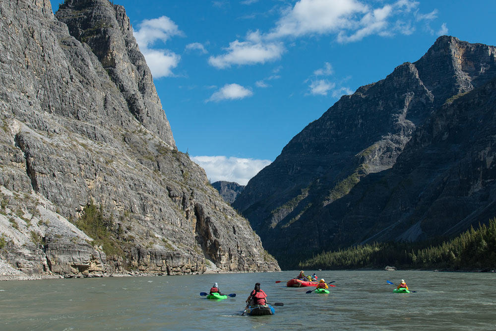 Canoeing through Canada's deepest canyons on the Nahanni River in Nahanni National Park Preserve.
