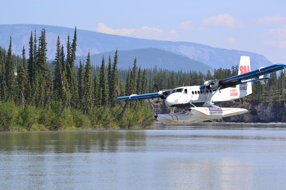A float plane landing on the Nahanni River in Nahanni National Park Preserve in Canada's Northwest Territories.