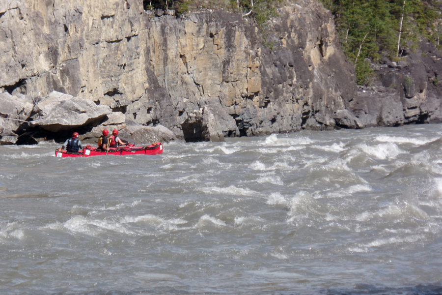 Paddling whitewater rapids on the Nahanni River in Nahanni National Park Preserve.