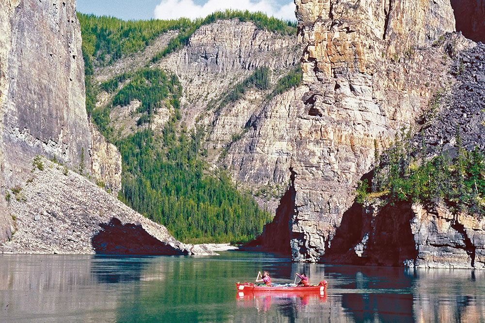 Canoeing through Canada's deepest river canyons on the Nahanni River in Nahanni National Park Preserve.