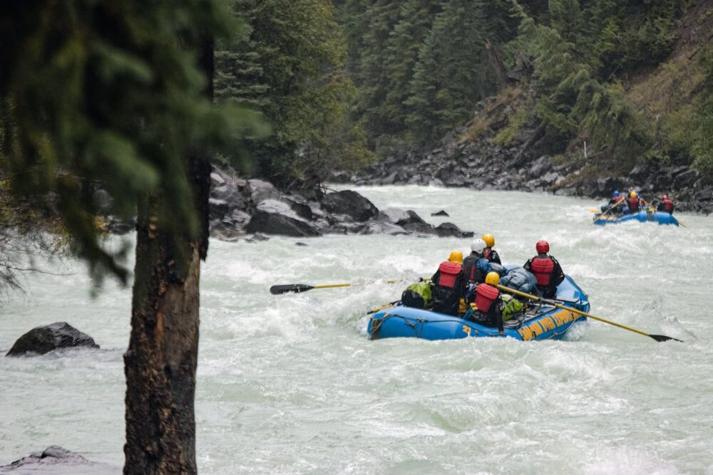 Photo: Rafters paddling through a set of rapids on the Taseko River