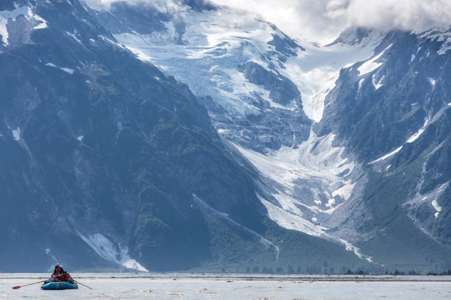 Rafters on the Tatshenshini River with a glacier in the background.
