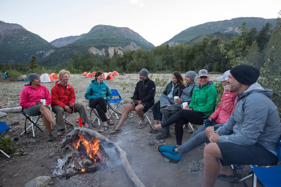 Rafters enjoying an evening campfire after a day of rafting the Tatshenshini River.