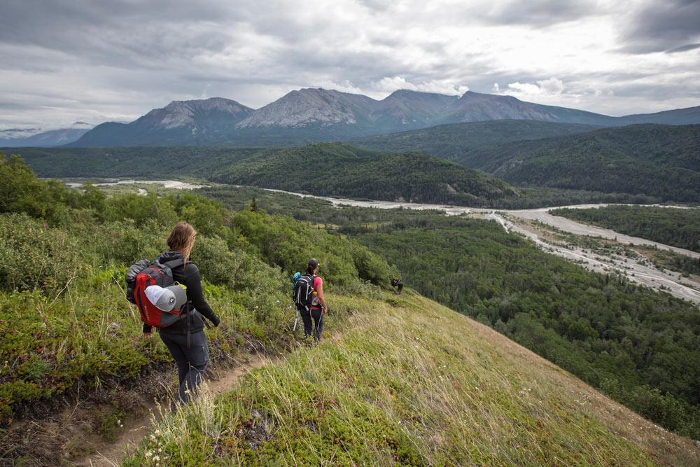 Hikers on a mountain high above the Tatshenshini River.