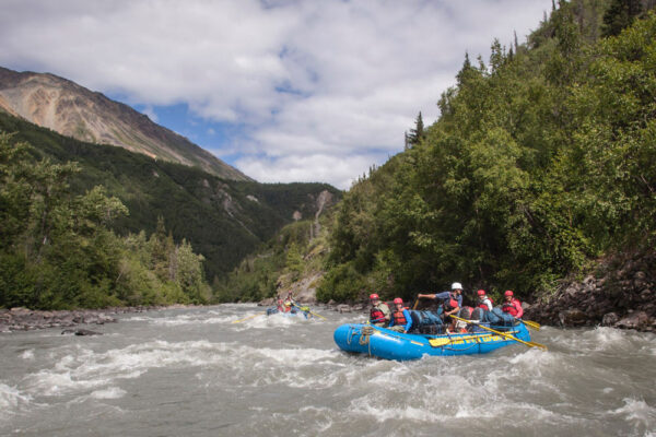 Rafting through rapids on the Tatshenshini River, which flows through the Yukon, British Columbia, Alaska, Glacier Bay National Park, Alsek/Tatshenshini Provincial Park, out to the Gulf of Alaska.