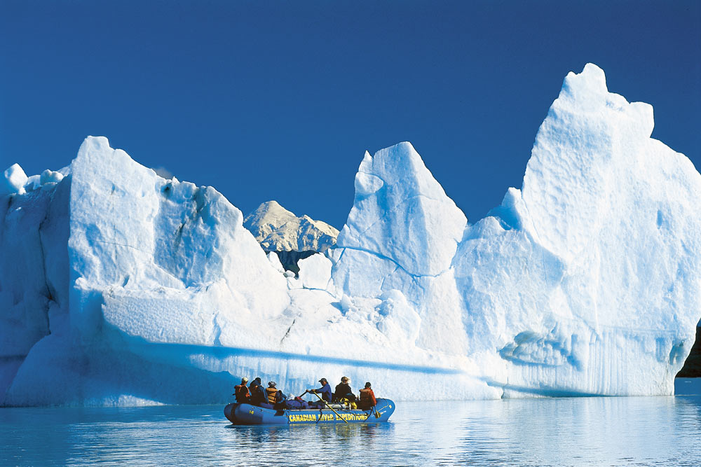 Rafting by Alsek Glacier where the icebergs are the small apartment buildings. Glacier Bay National Park, Alaska.