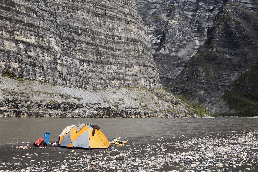 Camping on the shores of the Nahanni River in Nahanni National Park in Canada's Northwest Territories.