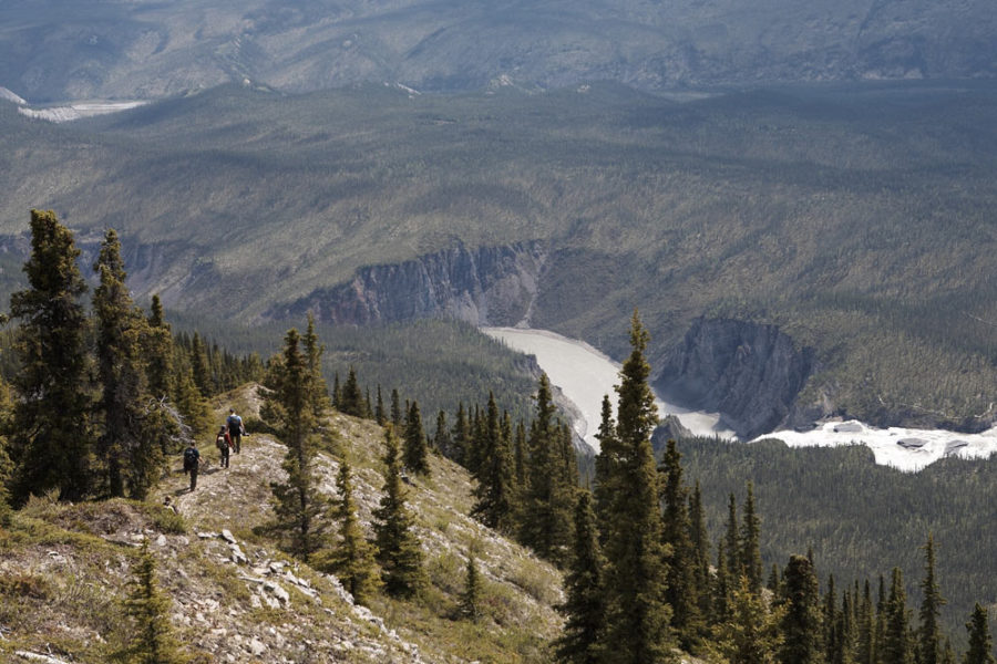 Hikers on their way back down from the peak of Sunblood Mountain, in Nahanni National Park Preserve, where they were awarded with an excellent view of the surrounding area.