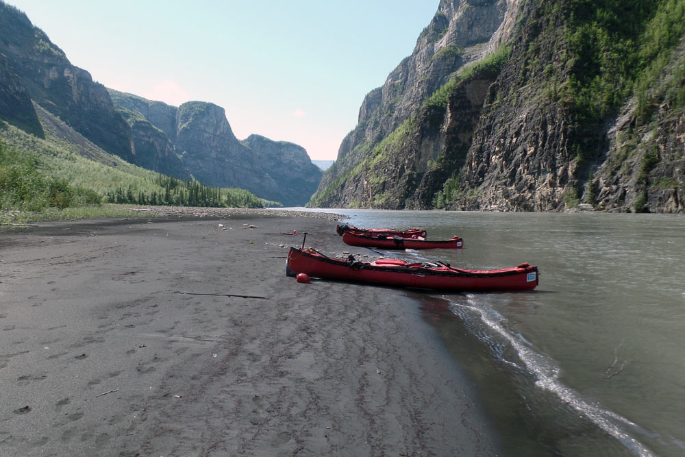 Canoes on the shore of the Nahanni River in Nahanni National Park Preserve.