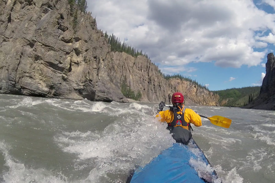 Paddling through rapids on the Nahanni River in Nahanni National Park Preserve in Canada's Northwest Territories.