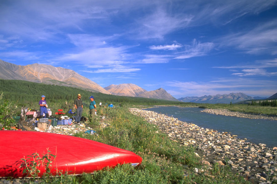 Paddlers having a shore lunch on the Snake River in the Peel Watershed, Yukon, Canada