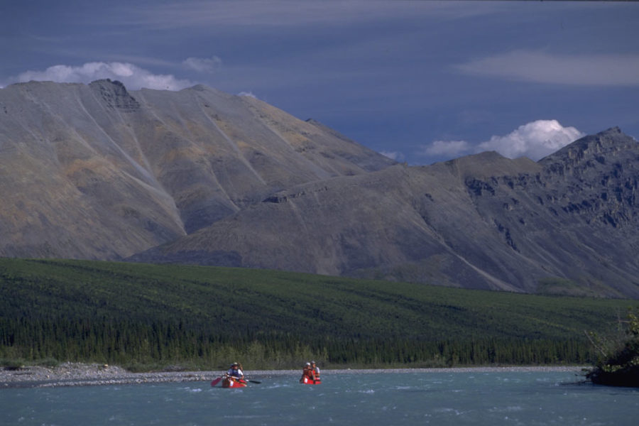 Two canoes paddling the Snake River in the Peel Watershed , Yukon, Canada.