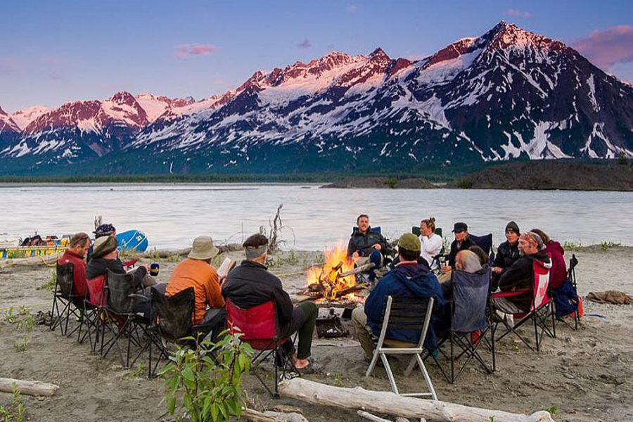 Rafting enjoying a bonfire after a day of rafting the Alsek River.
