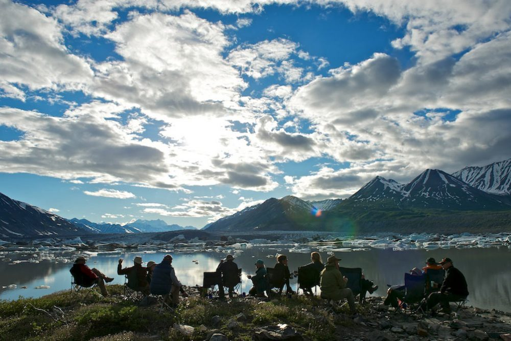 Rafters enjoying the spectacular view from camp on the Alsek River.