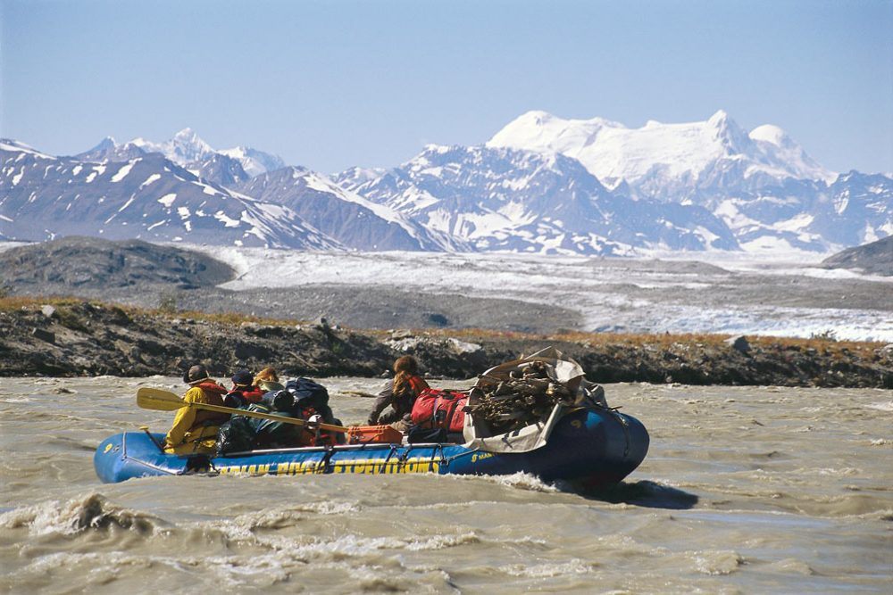 Rafting through rapids on the Alsek River, which is renowned for large rapids, dramatic mountain valleys and glaciers