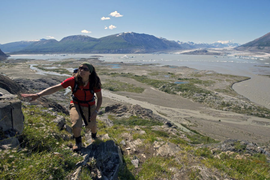 Hiker high above the Alsek River on our Alsek River Rafting Expedition.
