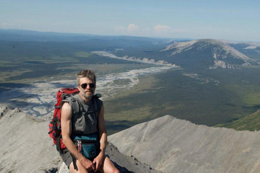Hiker on ridge, Wind River Canoeing, Yukon Territory, in the Peel Watershed.