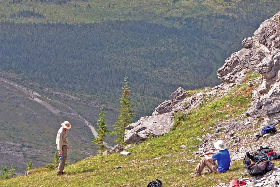 Hikers on ridge, Wind River Canoeing, Yukon Territory, in the Peel Watershed.