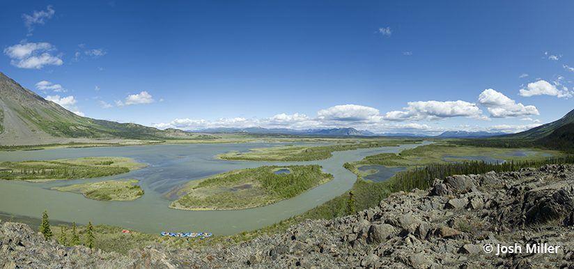 This hand-held stitched panorama of the upper Alsek watershed shows how the river begins as a slow meandering river before it later becomes a raging torrent through unraftable Turnback Canyon.