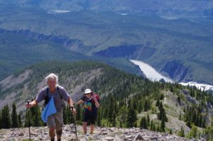 Hikers nearing the top of Sunblood Mountain in Nahanni National Park.
