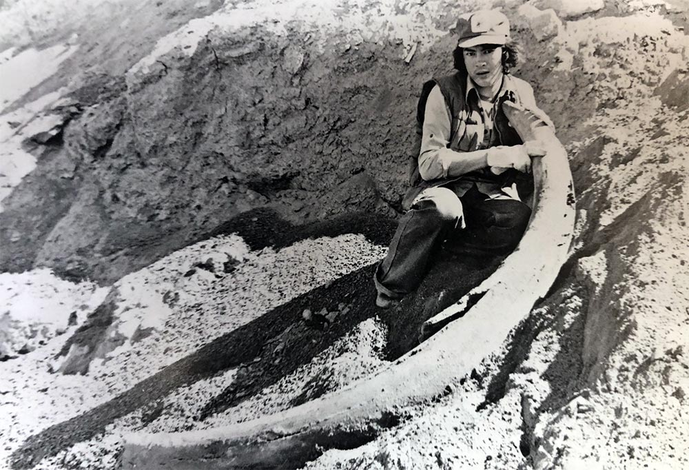 Old Crow resident Danny Kassi near Old Crow with a Mammoth Tusk, 1979.
